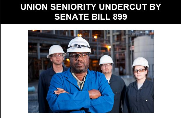 Factory workers in hardhats; union seniority undercut